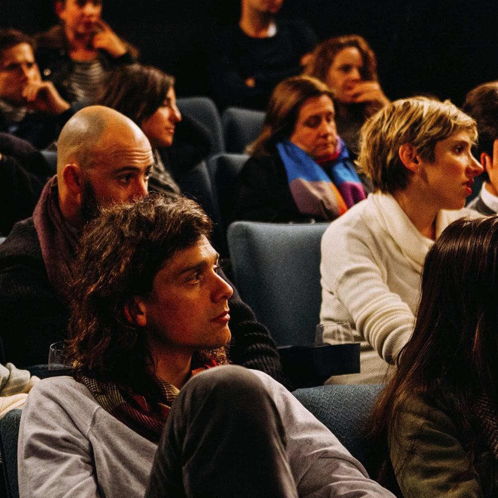 People sitting in a conference audience