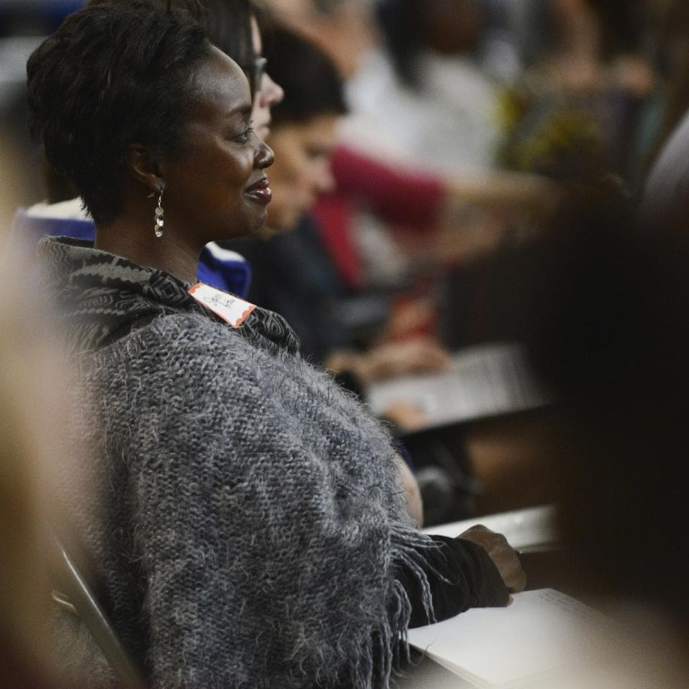 Woman sitting in a conference audience